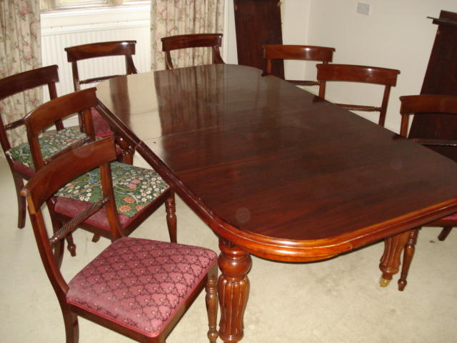 A reproduction mahogany Victorian style extending dining table and two leaves, on baluster reeded legs, table 290cm max extended, 100cm wide, and a set of eight rope back dining chairs.