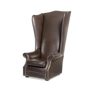 A leather upholstered porter's chair