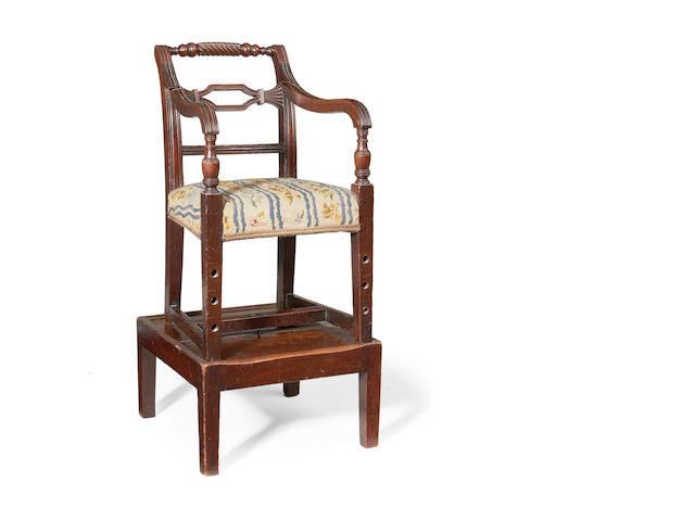 A George IV mahogany child's highchair in the manner of Gillows
