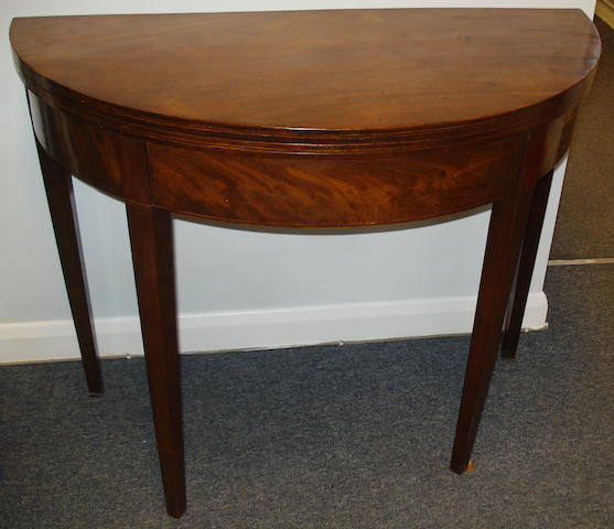A George III mahogany semi-circular tea table