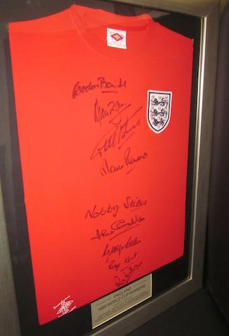 A 1966 England replica shirt hand signed by 9 England team