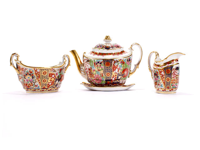 A Flight and Barr teapot and cover, a milk jug and sucrier and a Barr, Flight and Barr teapot stand, circa 1800-10