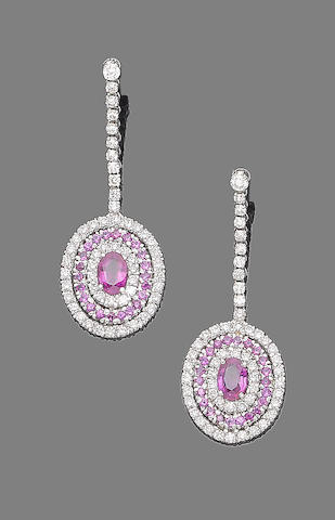 A pair of ruby and diamond pendent earrings,