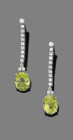 A pair of peridot and diamond pendent earrings