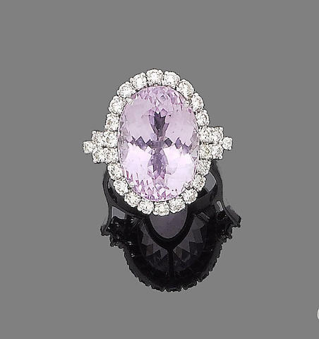 A kunzite and diamond ring,