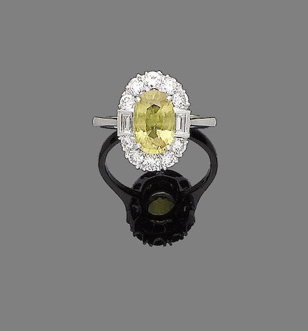 A yellow sapphire and diamond cluster ring,