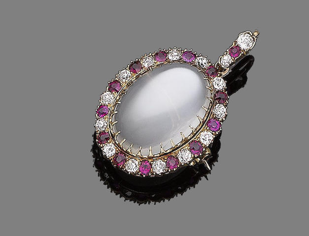 A moonstone, ruby and diamond pendant/brooch