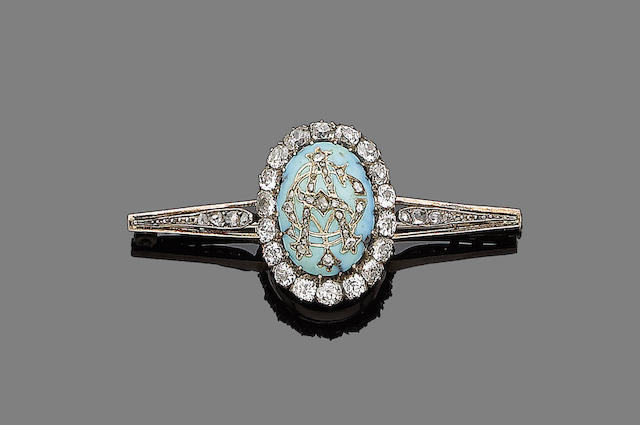 A late 19th century turquoise and diamond pendant/brooch