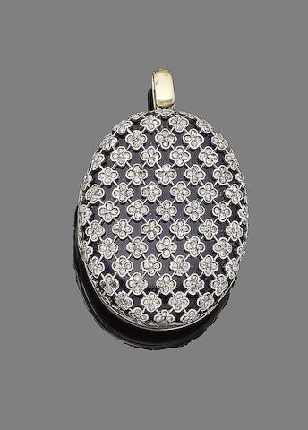 An early 20th century glass and diamond-set locket