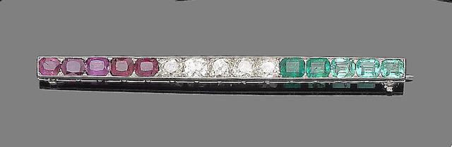 An emerald, ruby and diamond bar brooch