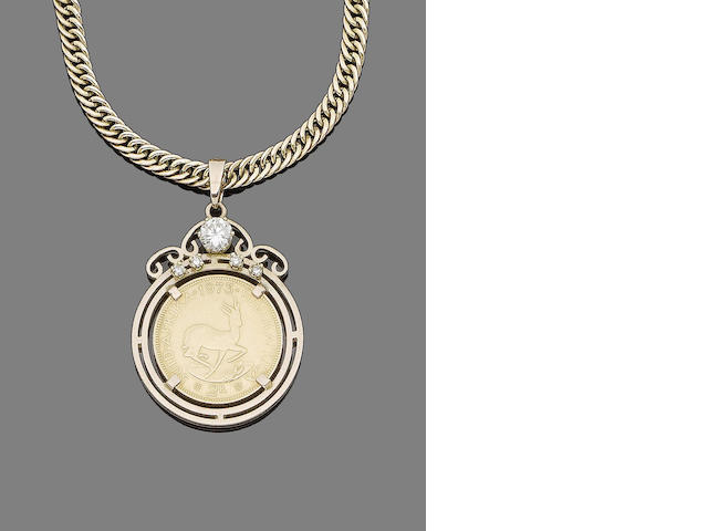A diamond-set coin pendant necklace