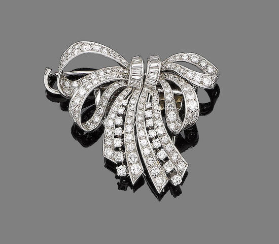 A diamond double-clip bow brooch