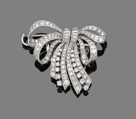 A diamond double-clip bow brooch