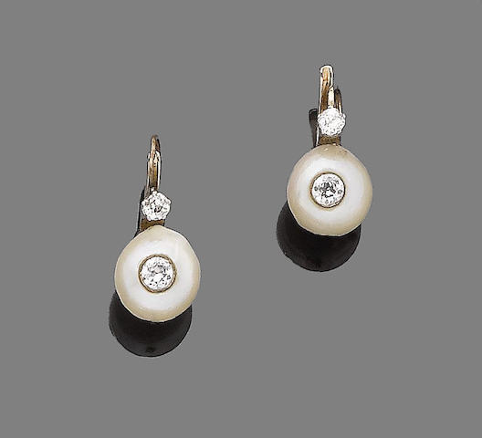 A pair of pearl and diamond earrings