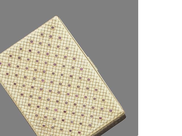 A ruby-set compact,  by Van Cleef & Arpels,