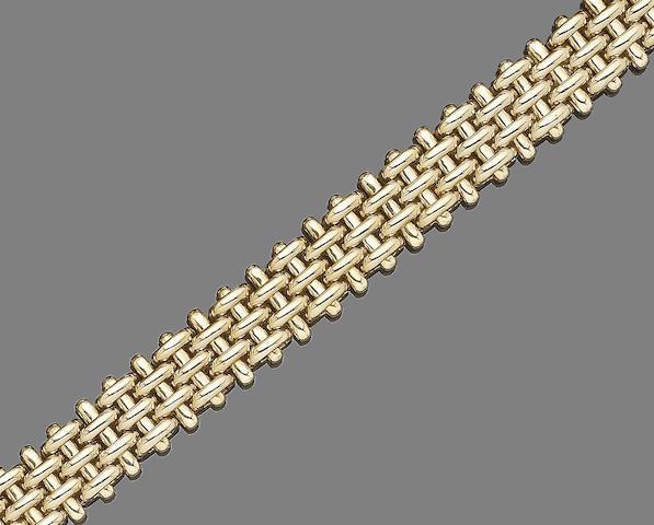 A gold necklace, by Asprey,