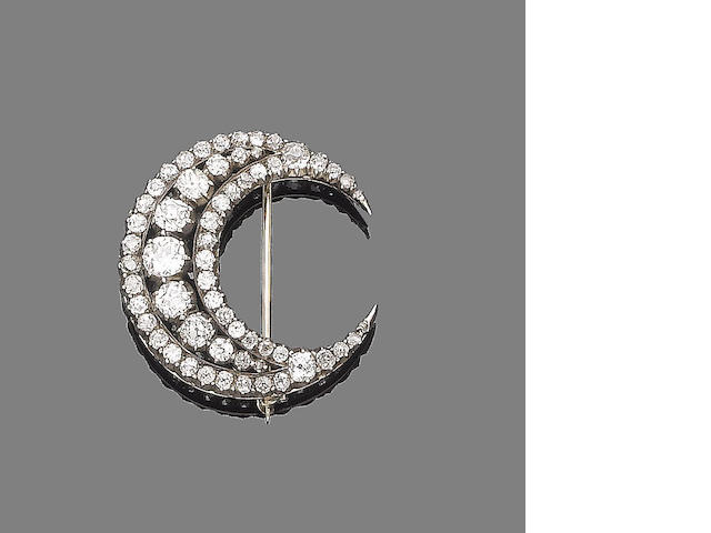 A diamond crescent brooch,