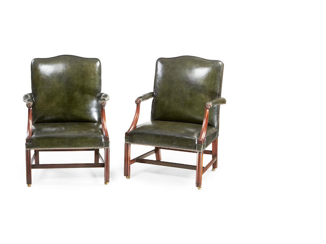 A pair of George III mahogany 'Gainsborough' armchairs