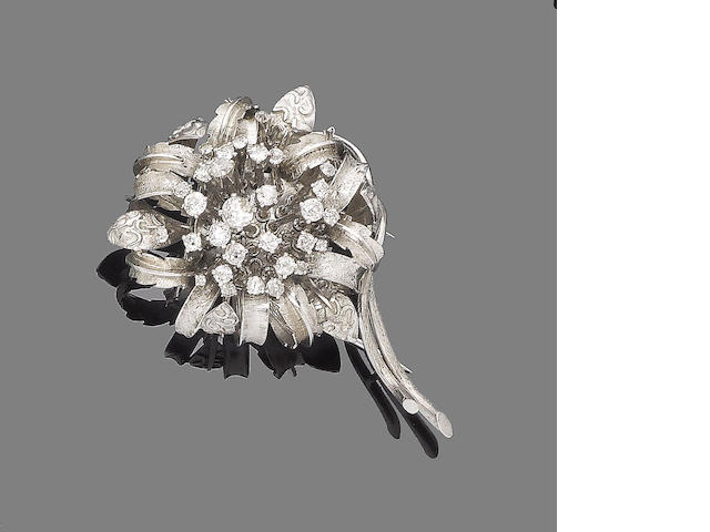 A diamond-set flower brooch