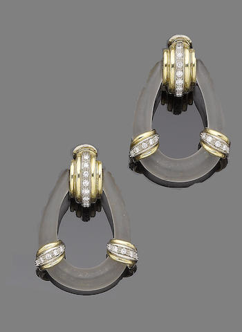 A pair of rock crystal and diamond pendent earclips