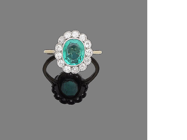 A emerald and diamond cluster ring,