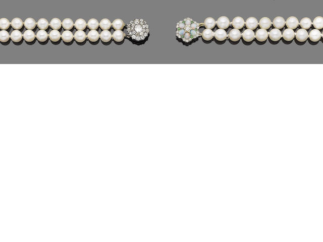 A pair of two-strand cultured pearl and gem-set necklaces (2)