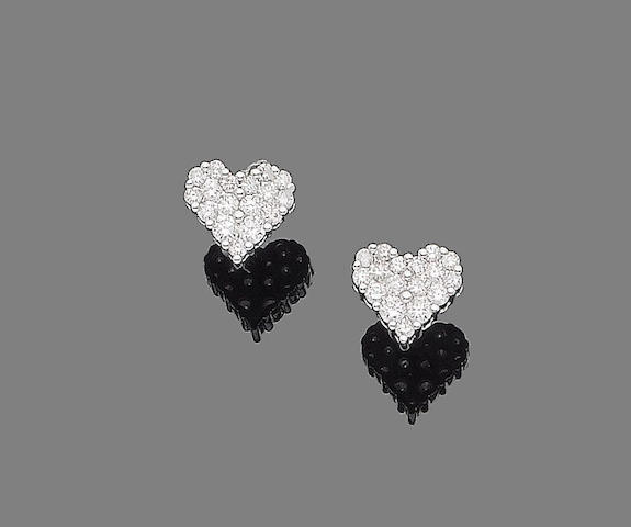 A pair of diamond heart earrings