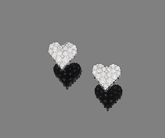 A pair of diamond heart earrings