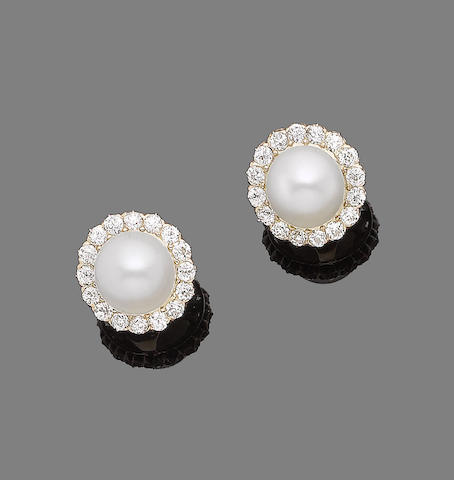 A pair of cultured pearl and diamond earrings