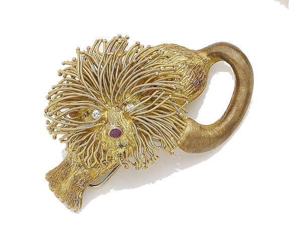 A ruby and diamond lion brooch, by Lalaounis