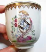 A famille rose export armorial part tea service Qianlong