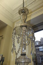 A late 19th century cut and moulded glass three-tier eighteen-branch chandelier