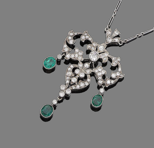 A belle époque emerald and diamond pendant necklace,