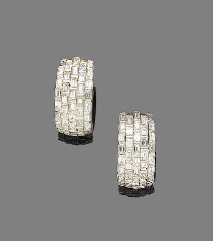 A pair of diamond earhoops, by David Morris