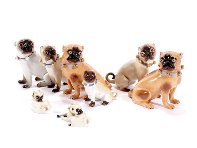 Two Meissen models of pugs, and six other porcelain pugs, 20th century