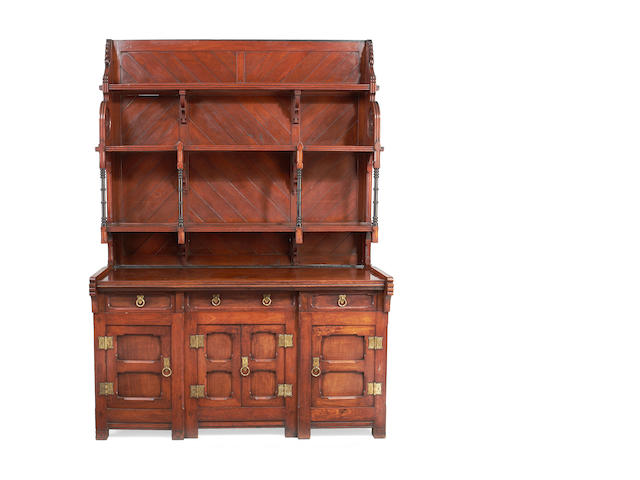 A mid Victorian 'Gothic revival' teak and padouk dresser after a design by C. L. Eastlake, possibly executed by Jackson & Graham,