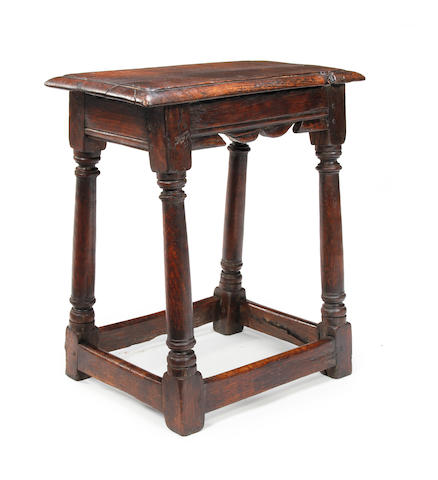 An oak joint stool 17th century style