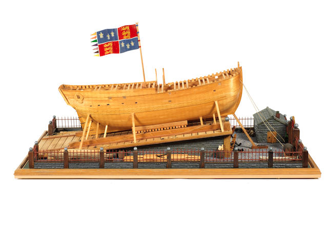 A modern diorama launching model of the Collier Earl of Pembroke (HMS Endeavour) 1764. 33.5x20x18.5ins (85x51x47cm)