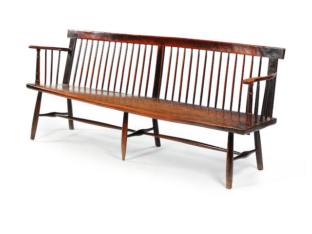 An early 19th century beech and elm stick-back settle West Country