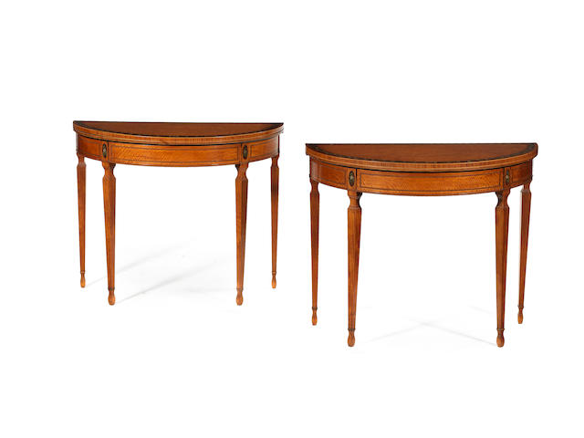 A pair of George III satinwood and painted and tulipwood banded semi-circular card tables