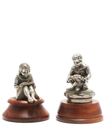 Boy and Girl figures (bookends mounted as mascots)