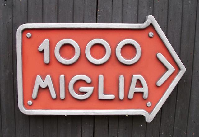 A 'Mille Miglia' garage display emblem,