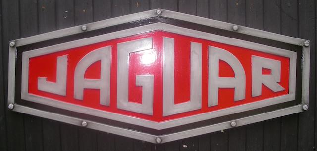 A Jaguar garage display emblem,