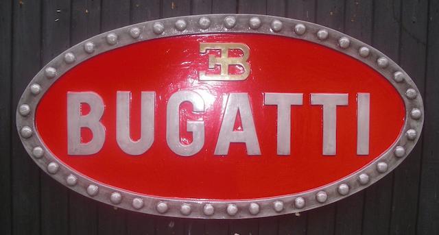 A Bugatti garage display emblem,