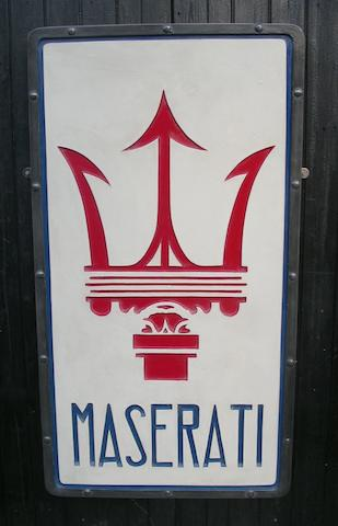A hand-painted Maserati garage display emblem,