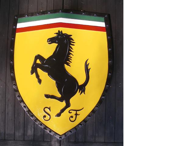 A hand-painted Ferrari garage display shield,