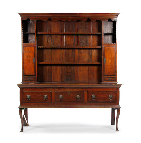 A George III oak and mahogany crossbanded dresser