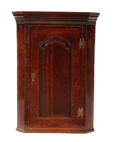 A George II oak mural corner cupboard