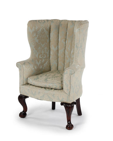 A George III style mahogany and upholstered barrel-back wing armchair
