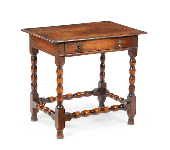 A late 17th century oak side table